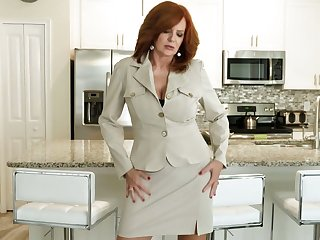 Red haired cougar Andi James is effectuation close by her grey jugs and hard to believe twat