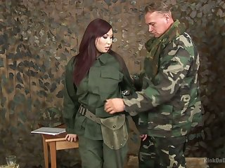 Asian chick in military uniform Aisha San gives a pleasurable blowjob to one soldier