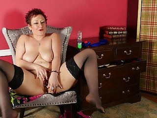 Short haired grown-up redhead Scarlett O Ryan masturbates with toys